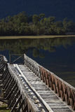 Wooden jetty on Lake Rosselot in the Aysen Region of Chile. Wooden jetty on the edge of the calm waters of Lake Rosselot located along the Carretera Austral in royalty free stock photography