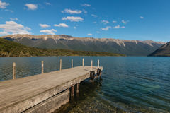 Wooden jetty at lake Rotoiti in Nelson Lakes National Park Royalty Free Stock Photo