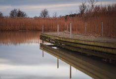 Wooden jetty by lake royalty free stock photos