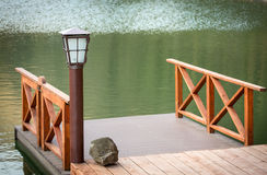Wooden jetty with lamp Stock Image