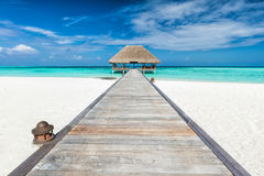Wooden jetty leading to relaxation lodge. Maldives islands royalty free stock photos
