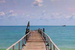 Wooden jetty leading to the seacoast Stock Image