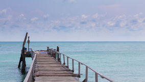 Wooden jetty leading to seacoast skyline. Natural landscape background Royalty Free Stock Image