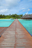 Wooden jetty leading to the tropical island Stock Photo
