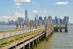 Wooden Jetty on Liberty Island facing Lower Manhattan Stock Image