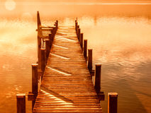 Wooden jetty 204. At a little lake in upper bavaria with mountains in background Stock Photo