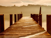 Wooden jetty 219. At a little lake in upper bavaria with mountains in background Royalty Free Stock Photography