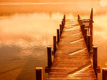 Wooden jetty 207. At a little lake in upper bavaria with mountains in background Stock Image