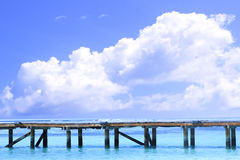 Wooden jetty at Maldivian sea Royalty Free Stock Photo