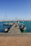 Wooden jetty at the marina in the fishing village of Zygi, Cyprus Stock Photography