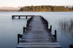 Wooden jetty at the mountain lake Royalty Free Stock Image