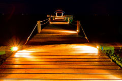 Wooden jetty in night scene. With beautiful light ray Royalty Free Stock Image