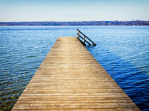 Wooden jetty. Old wooden jetty at a lake Royalty Free Stock Photos