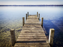 Wooden jetty. Old wooden jetty at a lake Royalty Free Stock Photography