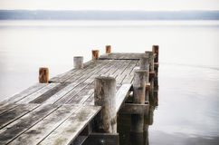 Wooden jetty. Old wooden jetty at a lake Stock Image