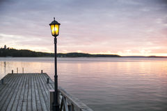 Wooden jetty with one lamp on it. Royalty Free Stock Images