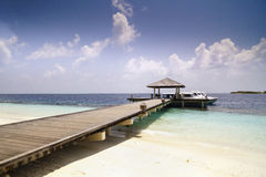 Wooden jetty over the beautiful Maldivian ocean Royalty Free Stock Photography
