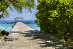 Wooden jetty over the beautiful Maldivian ocean Stock Photography