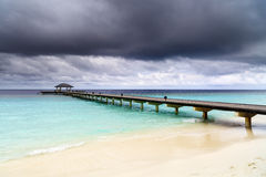 Wooden jetty over the beautiful Maldivian ocean Royalty Free Stock Photos
