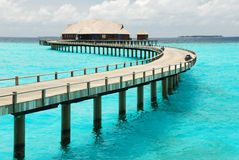 Wooden jetty over blue sea Royalty Free Stock Photo