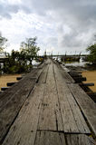 Wooden jetty over cloudy sky. Background Royalty Free Stock Photography