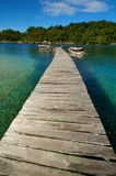 Wooden jetty over tropical beach Stock Photos
