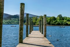 A wooden jetty or pier on a river or lake. stock photo