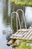 Wooden jetty with railings to the muskeg Stock Photography