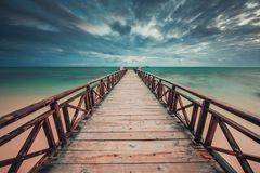 Free Wooden Jetty Reaching Into The Turquoise Caribbean Sea Royalty Free Stock Photo - 110835135