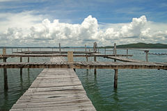 Wooden jetty in the sea. With beautiful sky background Stock Photography