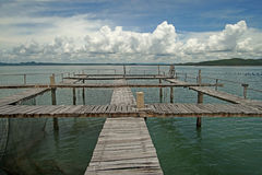 Wooden jetty in the sea. With beautiful sky background Stock Image