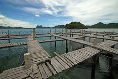 Wooden jetty in the sea. With beautiful sky background Stock Photo