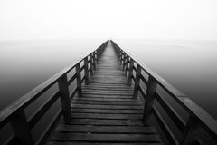 Wooden jetty into the sea Stock Images