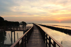Wooden jetty on seaside. With beautiful sunrise background Stock Photos