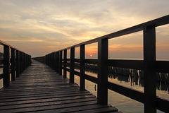 Wooden jetty on seaside. With beautiful sunrise background Royalty Free Stock Photography