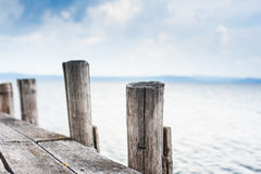 Wooden jetty stake in autumn day Stock Photography