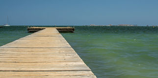 Wooden Jetty. A wooden jetty, stretching out into the Mediterranean sea Royalty Free Stock Images
