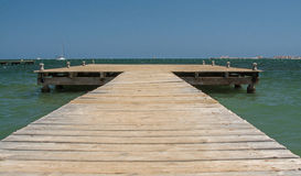 Wooden Jetty. A wooden jetty, stretching out into the Mediterranean sea Royalty Free Stock Photography