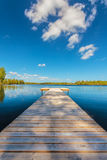Wooden jetty on a sunny day in Sweden Stock Image