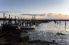 Wooden Jetty at Sunset. Sunset at a wooden jetty in Poole harbour Royalty Free Stock Photo