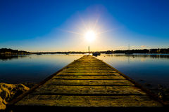 Wooden jetty and sunset Stock Photography