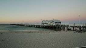 Wooden jetty at sunset. Wooden jetty in Busselton Beach, Western Australia at sunset colors. Iconic landmark in Busselton, WA stock video