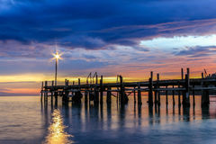 Wooden jetty and sunset. Wooden jetty extending into the sea, in Royalty Free Stock Image