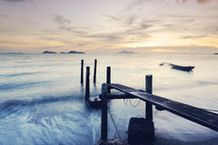 Wooden jetty during sunset Stock Images