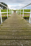 Wooden jetty to a concrete staircase on a dike Stock Photo