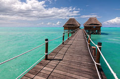 Wooden jetty to ocean huts Stock Photo