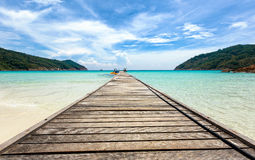 Wooden jetty in to the sea. On Pulau Redang, Malaysia Royalty Free Stock Photography