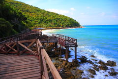 Wooden jetty to the tropical beach. On island, at koh lan island Pattaya city Chonburi Thailand Royalty Free Stock Photography