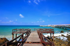 Wooden jetty to the tropical beach Royalty Free Stock Images