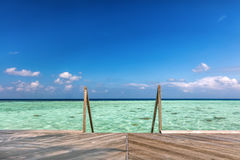 Wooden jetty towards water villas in Maldives. Stock Images